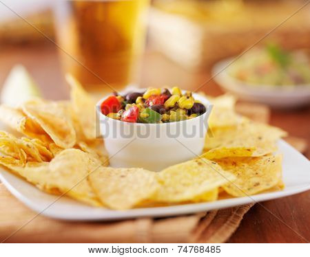 mexican fire roasted corn and black bean salsa with tortilla chips and beer