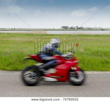 Fast Motorcyclist inNature