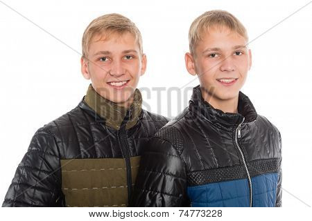 Twin brothers in autumn clothes isolated on white