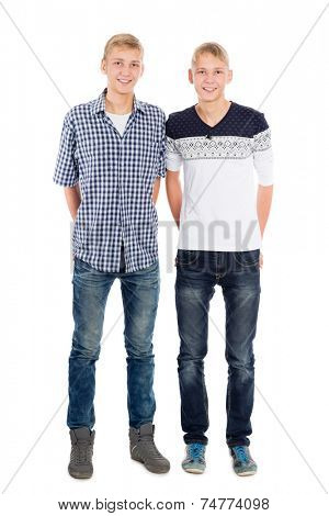 Portrait of twin brothers isolated on white background