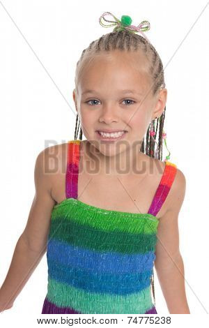 Beautiful girl on a white background. Girl is six years old.
