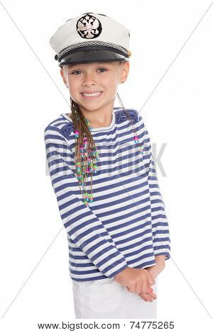 Playful little girl six years old in a suit cabin boy. Girl is six years old. On her cap emblem of Russia.