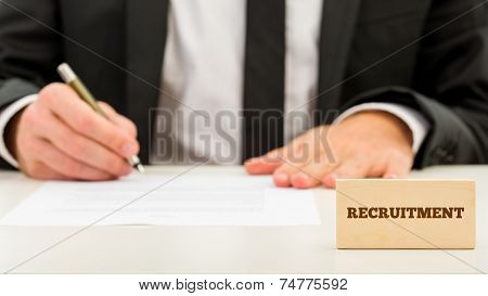 Applicant Completing A Job Application