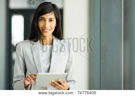 portrait of happy indian career woman using tablet pc
