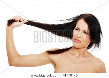 Young angry woman pulling hair