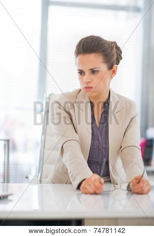 Portrait Of Concerned Business Woman With Eyeglasses In Office