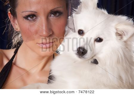 Portrait Of Young Pretty Widow Woman In Black And White Dog