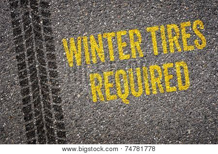 Lane with the text Winter tires required
