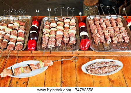 Skewers Of Raw Lamb Shish Kebabs And Vegetables
