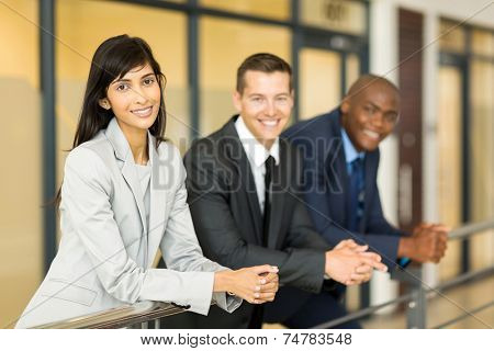 portrait of pretty indian business woman with co-workers