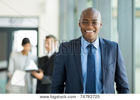 handsome young african american businessman in office