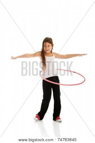 Happy little girl with hula hoop