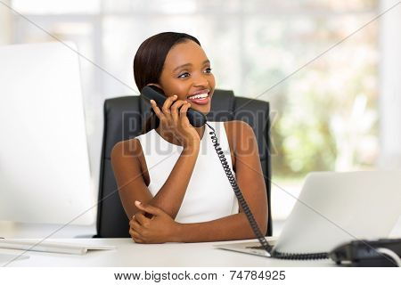 attractive african american businesswoman using landline phone