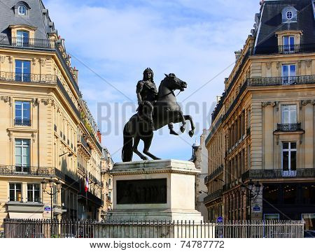 Statue Of Louis Xiv In The Center Of The Place Des Victoires In Paris, France