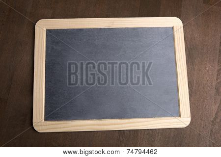 Writing Tablet On A Brown Background