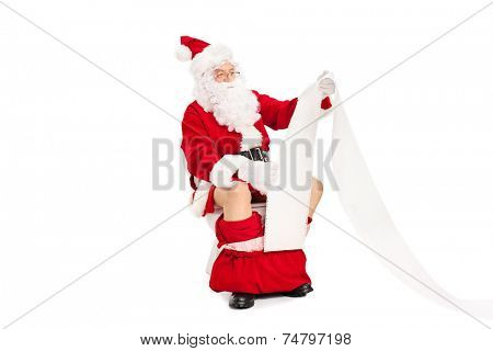 Santa seated on toilet and reading a paper isolated on white background