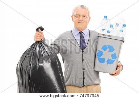 Senior holding a recycle bin and a garbage bag isolated on white background