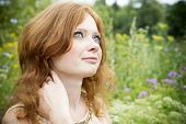picture of redhead  - Portrait of redhead girl with blue eyes on nature - JPG