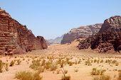 picture of arid  - Arid mountain landscape in Wadi Rum desert in Jordan - JPG