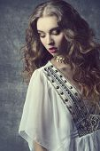 stock photo of vintage jewelry  - Retro fashion shoot of sexy curly haired woman wearing vintage jewelry - JPG