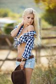 picture of cowboys  - Young woman portrait of a cowboy in the open air - JPG