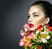 stock photo of woman glamorous  - High fashion model girl with colorful flowers and red lips - JPG
