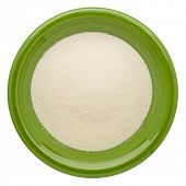 picture of collagen  - collagen protein powder on an isolated green ceramic bowl - JPG