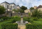 foto of pews  - Monastery of Nouaille Maupertuis with church tower and garden - JPG