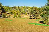 stock photo of miniature golf  - mini golf park in sport resort in sunny day - JPG