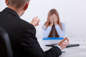 stock photo of candid  - Young boss bullying the candidate in her job meeting - JPG