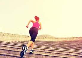foto of japanese woman  - Runner athlete running on stairs. woman fitness jogging workout wellness concept. ** Note: Visible grain at 100%, best at smaller sizes - JPG