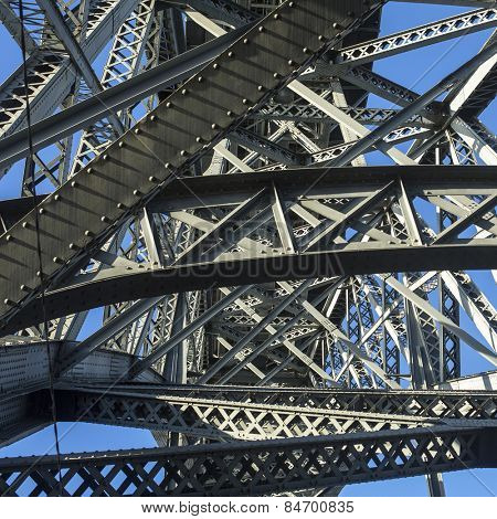 Bottom view of metalworks famous Dom Luis I Bridge in Porto, Portugal.