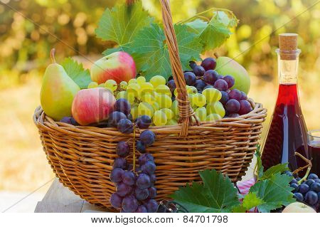 Fresh autumn fruits and red wine