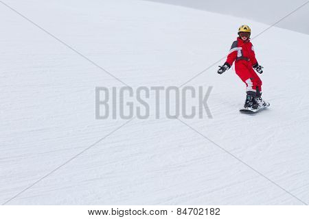 Little Girl Snowboarder Riding Down At Ski Slope  In French Alps