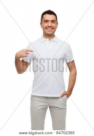 happiness, advertisement, fashion, gesture and people concept - smiling man in t-shirt pointing finger on himself