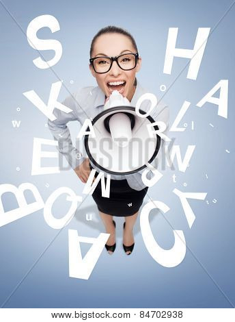 business and office concept - screaming businesswoman in eyeglasses with megaphone