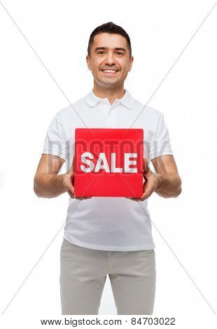 shopping, consumerism, discount and people concept - smiling man with red sale sigh