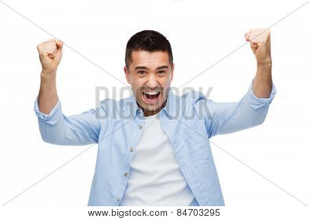 happiness, gesture, emotions and people concept - happy laughing man with raised hands