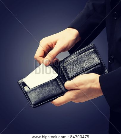 man in suit with wallet and credit card