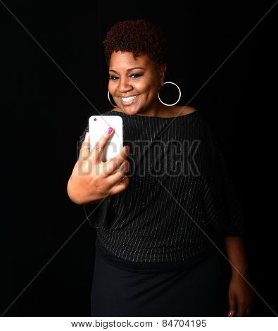 Nice Image of a afro american woman taking a picture