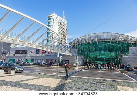 Lisbon, Portugal - February 01, 2015: People crossing the road in front of the Vasco da Gama Shopping Centre entrance. Parque das Nacoes (Park of Nations).