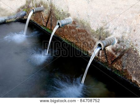Source of three pipes with crystal clear water of the mountain