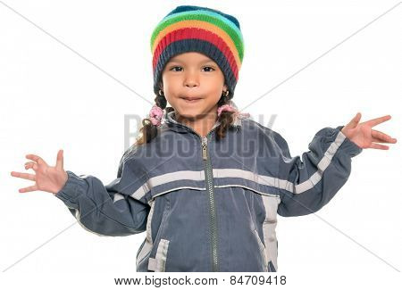 Mixed race little girl with a funny attitude wearing a colorful beanie hat and a jacket isolated on white