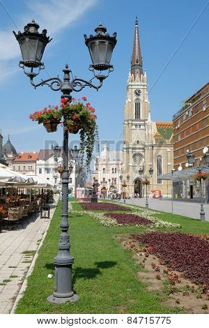 NOVI SAD, SERBIA - AUGUST 03: old style street light and the Catholic Cathedral in main square of Novi Sad. Shot in 2014