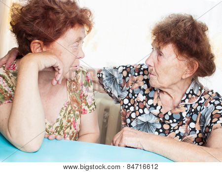 Two elderly women. Seniors at home. Friendship