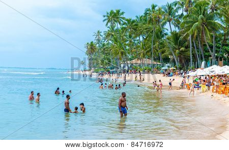 BAHIA, BRAZIL - CIRCA NOV 2014: People enjoy a sunny day at Praia do Forte (Forte Beach) in Bahia, Brazil.