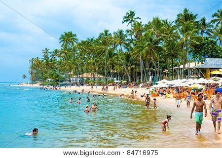BAHIA, BRAZIL - CIRCA NOV 2014: People enjoy a sunny day at Praia do Forte (Forte Beach) in Bahia, Brazil.