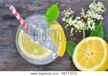elderflower juice with lemon on old table