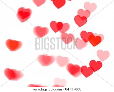 red heart bokeh on white background