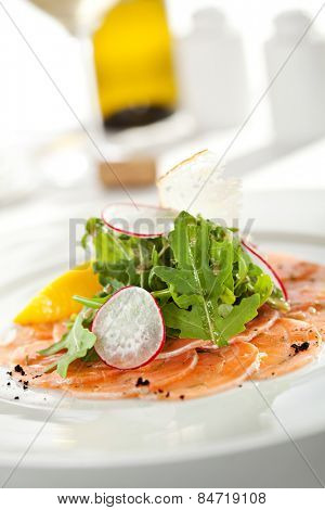 Appetizer - Salmon Carpaccio with Parmesan Cheese and Rucola